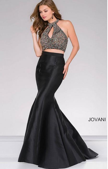 Robe de soirée Dubai et libanaise Jovani. Robe de bal chic et élégante, robe noire et blanche brillante deux pièces. Robe moulante sexy pour invitée mariage, bal ou gala. Robe en location ou vente paris.